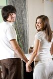 Girl with long hair and boy on kitchen Royalty Free Stock Image