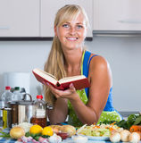 Girl with long hair cooking vegetables in kitchen. Pretty  girl with long hair cooking vegetables in kitchen Stock Photo