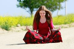 Girl with long hair on country road Stock Photos