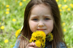 Girl with long hair and dandelions in spring Stock Images