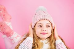 Girl long hair dream pink background. Kid dreamy face wear knitted accessory. Winter fashion accessory. Kid girl wear royalty free stock images