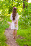 Girl with long hair in a forest Royalty Free Stock Images