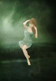Girl with long hair in green dress Royalty Free Stock Image