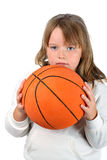 Girl with long hair holding basketball isolated Royalty Free Stock Images
