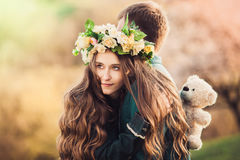 Girl with long hair hugging her guy. Close-up Royalty Free Stock Photography