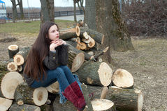 Girl with long hair on logs Stock Photo