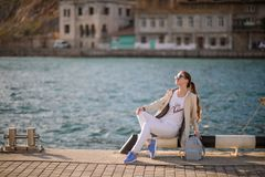 Beautiful girl outdoors. Spring day. The girl with long hair near the sea stock photos