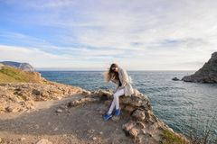 Beautiful girl outdoors. Spring day. The girl with long hair photographes itself near the sea royalty free stock photography