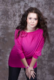 Girl with long hair in a pink blouse Royalty Free Stock Images