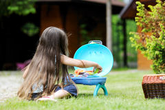 Girl with long hair play with toy Royalty Free Stock Photos