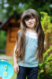 Girl with long hair play with toy Royalty Free Stock Photography