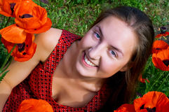 Girl with long hair in poppies field Royalty Free Stock Image
