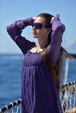 Girl with long hair in a purple dress Stock Image