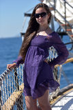 Girl with long hair in a purple dress Royalty Free Stock Image