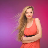 Girl with long hair on rainbow background. Wind in your hair. Blonde. Stock Images