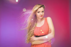 Girl with long hair on rainbow background. Wind in your hair. Blonde. Royalty Free Stock Image