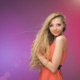 Girl with long hair on rainbow background. Wind in your hair. Blonde. Royalty Free Stock Photos