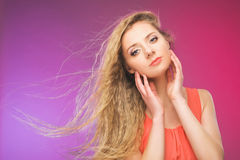 Girl with long hair on rainbow background. Wind in your hair. Blonde. Stock Photo