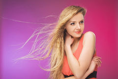 Girl with long hair on rainbow background. Wind in your hair. Blonde. Royalty Free Stock Images