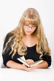 Girl with long hair reads Royalty Free Stock Photo