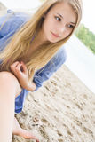 Girl with long hair in the sand Royalty Free Stock Photography