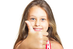 girl with long hair shows thumb Stock Photo