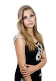 Girl with long hair standing in a half-turn. On a white background Stock Photography