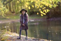 girl with long hair standing by the pond on a sunny day royalty free stock photos