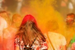 A girl with long hair strewn with red colored paint celebrates the Holi festival Dnipro city, stock images
