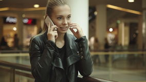 Girl with long hair, talking on the phone stock footage
