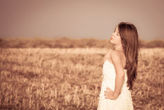 A girl with long hair in a white dress Royalty Free Stock Image