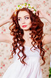 Girl with long hair in a wreath Royalty Free Stock Photo