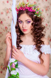 Girl with long hair in a wreath Royalty Free Stock Images