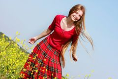 Girl with long hair in yellow flowers Royalty Free Stock Photo