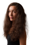 Girl with long hairs. Portrait of girl with long ringleted hairs, looking ahead royalty free stock photo