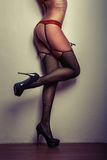 Girl long legs in stockings with suspender belt Royalty Free Stock Images
