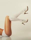 Girl long legs, white high heels. Sexy girl long legs, white high heels and stockings Royalty Free Stock Images