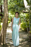 Girl in a long light blue dress Royalty Free Stock Photography