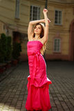 Girl in long pink dress on street of old town Royalty Free Stock Images