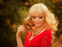 Girl in a long red dress  in the autumn forest Royalty Free Stock Images