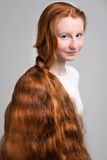 Girl with long red hair Stock Photo