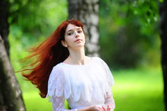 The girl with long red hair Stock Image