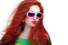 Girl with long red hair in fashion sunglasses Stock Images