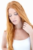 Girl with long red hair thinking royalty free stock photo
