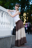 Girl in a long skirt Stock Photography