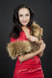 Girl with long tailed fur Stock Images