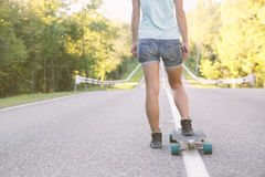 Girl with longboard. Stock Photos