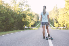 Girl with longboard. Royalty Free Stock Image