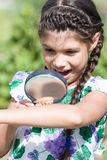 Girl look at beetle on your hand through magnifying glass Stock Photography