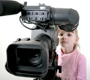 Girl look in the camcorder Royalty Free Stock Photos